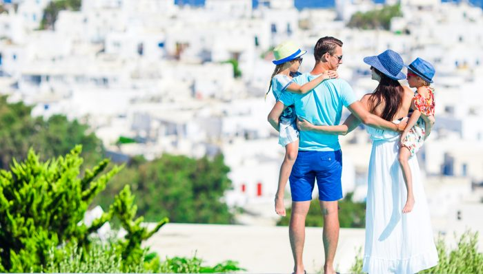 Family-of-four-on-vacation-www.istockphoto